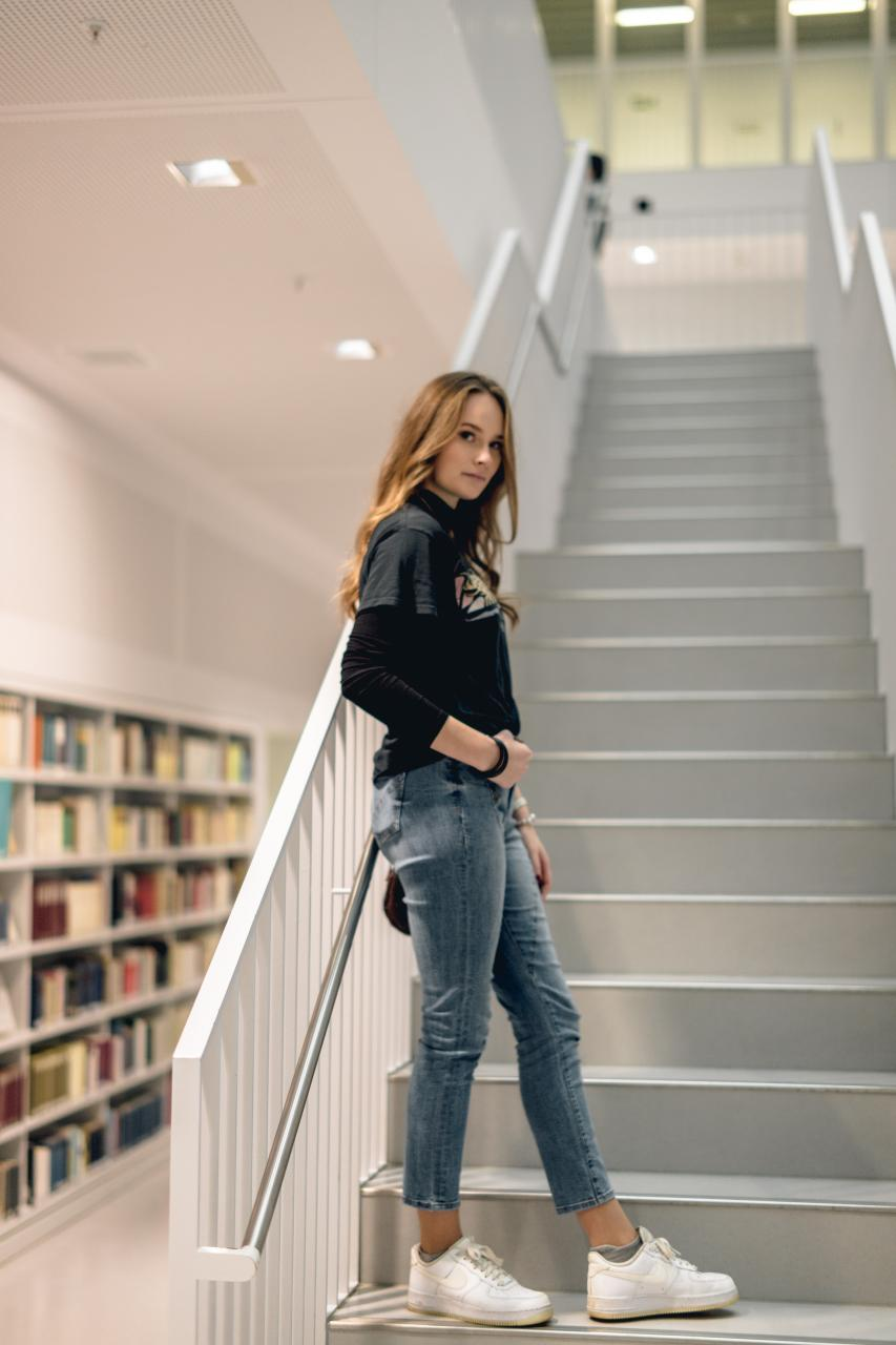 woman leaning on staircase